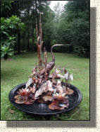 Model Two Large fancy copper heron fountain. About 4 feet wide and five foot tall.