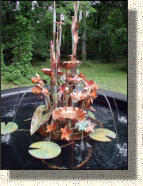 "Model Three copper iris fountain about 4 feet tall and 32"" wide."