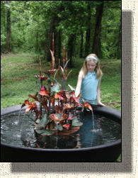"Model One copper fountain with orchids. About 4 feet tall and 32"" wide."