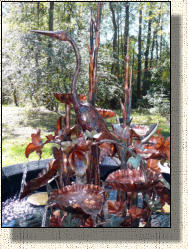 Model Nine: Large copper heron fountain with bowls.